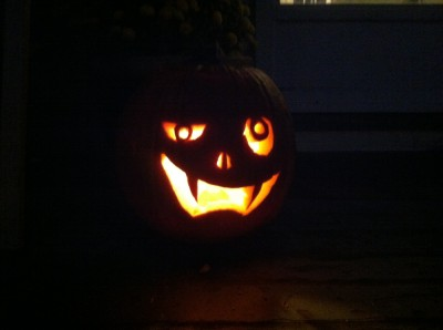 jack-o-lantern's fanged grin in the dark