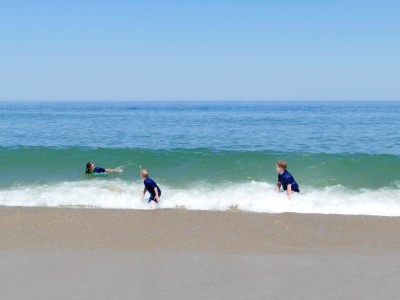 Harvey and Zion preparing to ride a moderate-sized wave