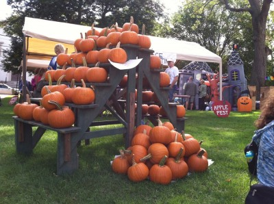a display of pumpkins at a church fair