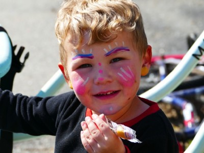 Lijah in beautiful multi-colored face paint