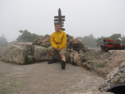Dan sitting at the foggy top of Champlain mountain