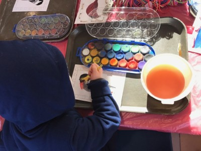 Lijah watercoloring a bird picture