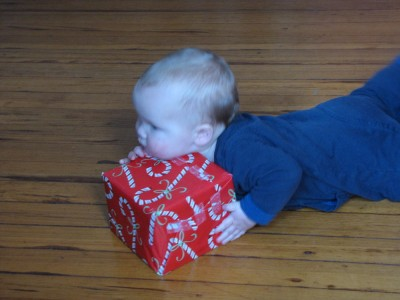Elijah resting his chin on a present