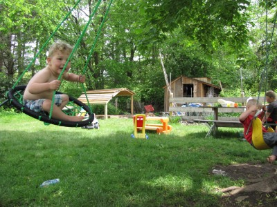 Lijah swinging in the backyard
