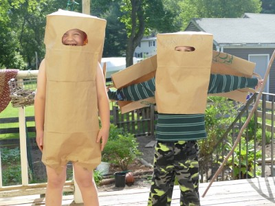 Zion and Lijah in costumes made out of paper grocery bags