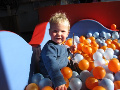 Lijah in a sunbeam in a ball pit