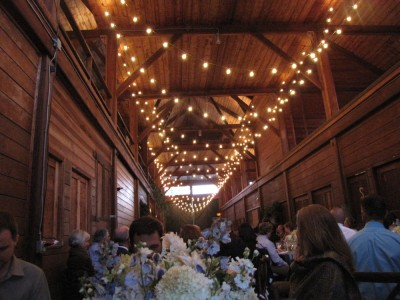 the reception barn decked with lights