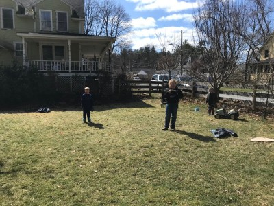 the boys playing catch in the yard