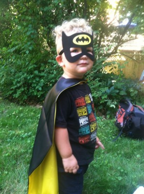 Lijah in a Batman cape and mask