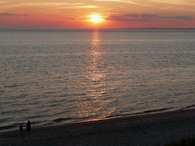 the sunset over Cape Cod Bay