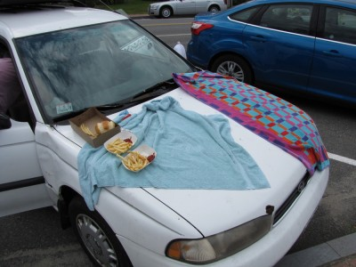towels and fried food on the hood of the car