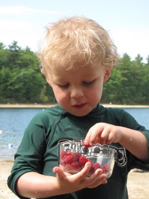 Zion eating raspberries at the pond