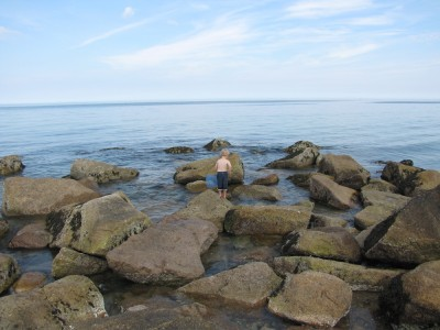 Zion with his net, looking for creatures among the rocks
