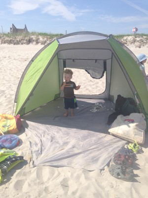 Lijah standing in the new beach tent