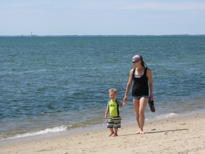 Mama and Lijah walking on the beach