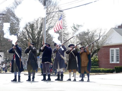 minuteman firing a volley in the Pole Capping parade