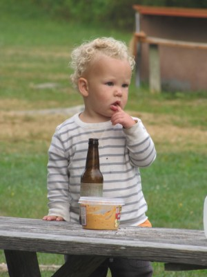 Lijah sitting at the picnic table with a bottle of beer