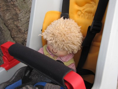 Harvey's doll reposing in the kid seat