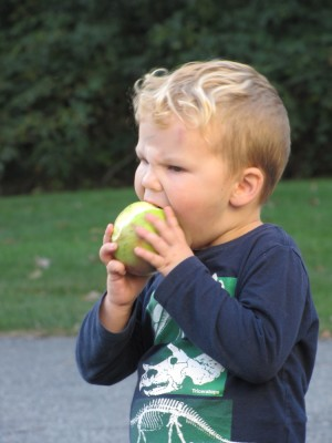 Lijah biting an apple