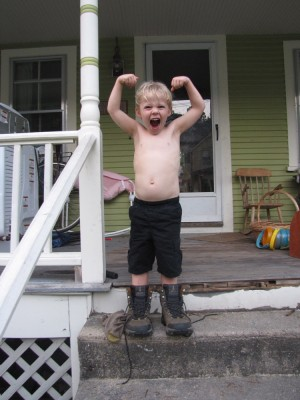 Zion making a muscle pose wearing my hiking boots