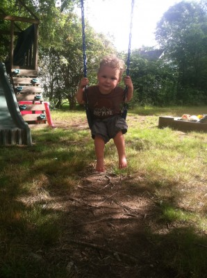 Lijah swinging on the neighbors' swing