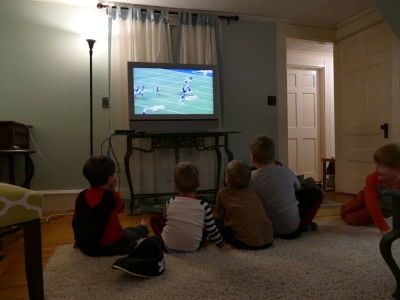 the boys watching football with friends