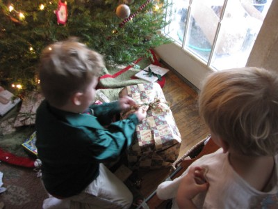 Harvey opening a present, Zion watching