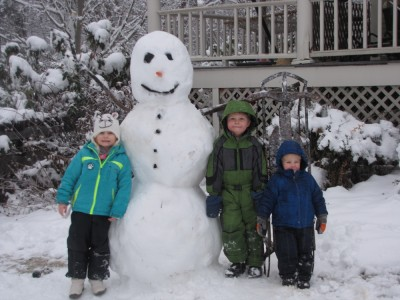Harvey, Zion, and their friend pose with my big snowman