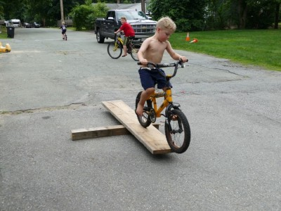 Zion guiding his bike over a small ramp