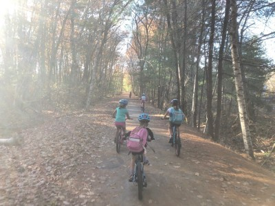 kids riding on a dirt bike path