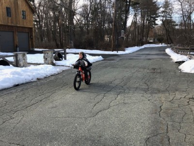 Elijah riding his new bike on our street
