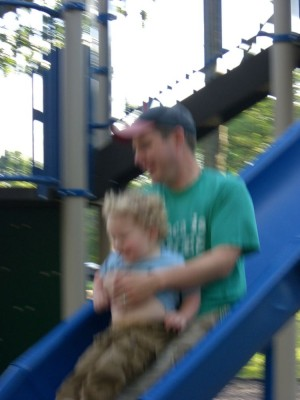 harvey sliding down the slide with dada