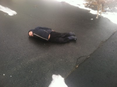 Zion lying on the ground on the black ice