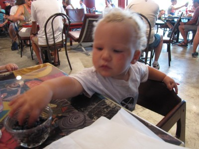 Lijah reaching for blueberries at the cafe