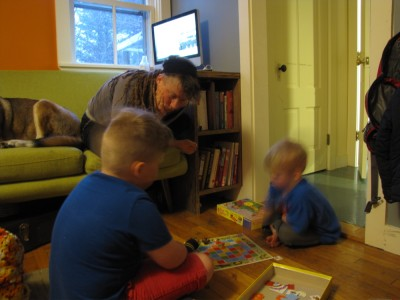 Leah and the older boys playing a board game