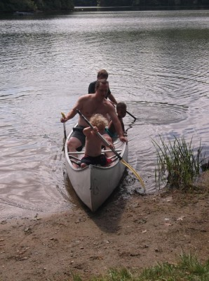 the canoe with Dan, Harvey, Nisia, and Uncle Tom
