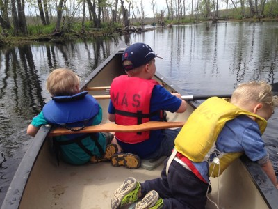 the boys on the water in a canoe