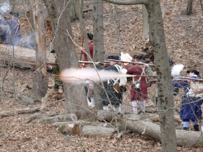 reenactors firing a volley