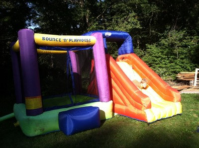bounce-house; Harvey head-first down the slide