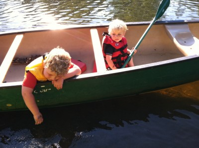 Zion and Harvey in a canoe on the river