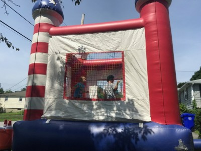 Zion and Lijah in a castle-shaped bounce house