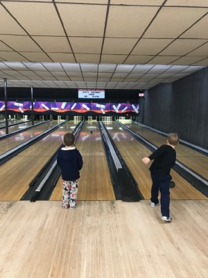 Lijah and Zion bowling in adjacent lanes