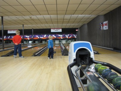 Harvey and Zion bowling on neighboring lanes