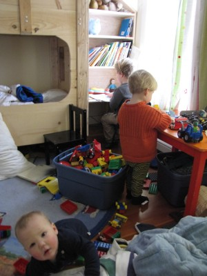Lijah, Zion, and Harvey playing in their bedroom
