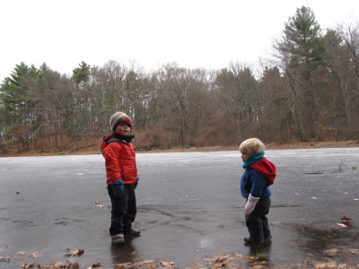 Harvey and Zion sliding  (carefully) on pond ice