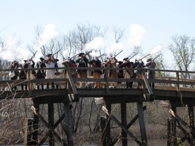 Sudbury Minutemen firing a volley from the Concord Bridge