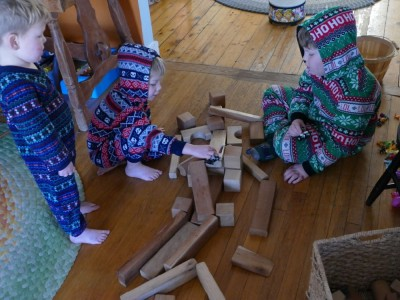 the boys in pjs playing with blocks
