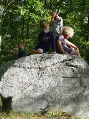 the boys and a friend atop one of the Two Brothers Rocks