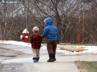 Zion and Harvey walking down the sidewalk together