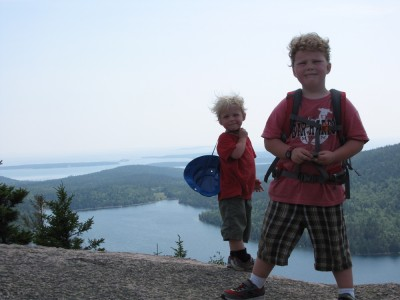 Zion and Harvey atop North Bubble, with Jordan Pond and the Atlantic Ocean behind them